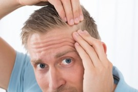 man checking hair for lice
